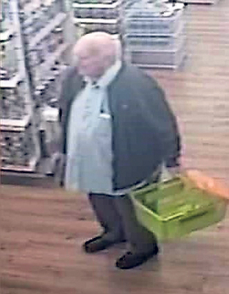 Man wanted over assault in shop